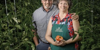 man and woman with tomatoes