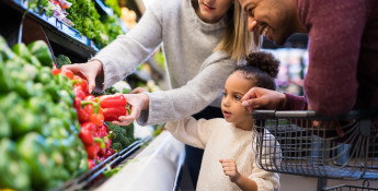 family buying vegetables