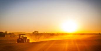 farmer preparing field