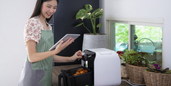 Woman using air fryer