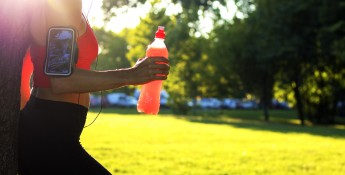 woman drinking red drink after workout
