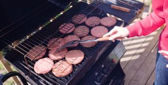 woman grilling hamburgers
