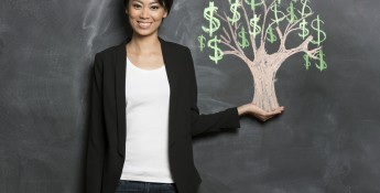 Woman standing next to a money tree