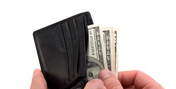 hundred dollar bills and wallet