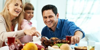 family eating turkey leftovers