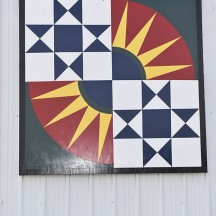 Blue, yellow and red barn quilt