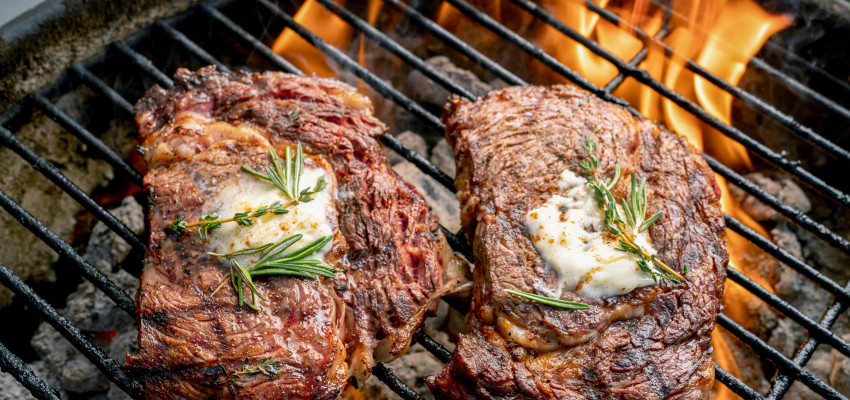Grilling steaks in the summer
