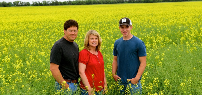 Peirce family in canola field