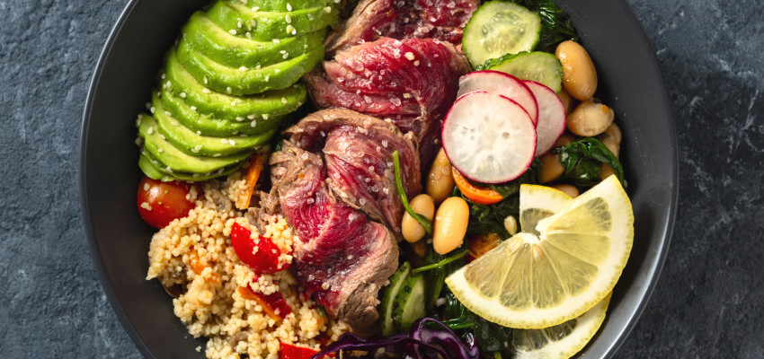 Buddha bowl with steak, quinoa and avocado