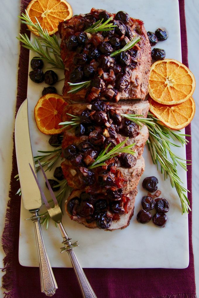 cherry-balsalmic-roasted-pork-loin-top-view-of-sliced-roast-with-dried-oranges
