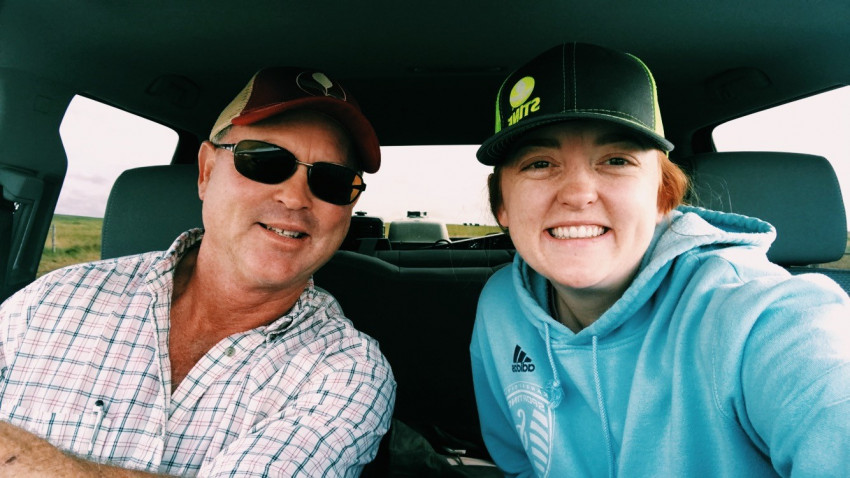 Leigh Ann with her dad in pickup