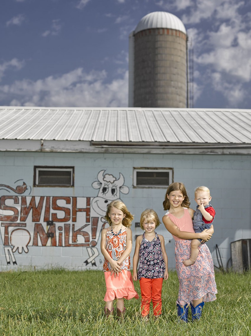 kids in front of milk sign