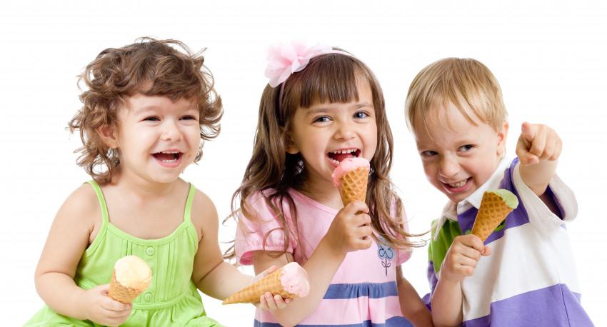 three kiddos eating ice cream