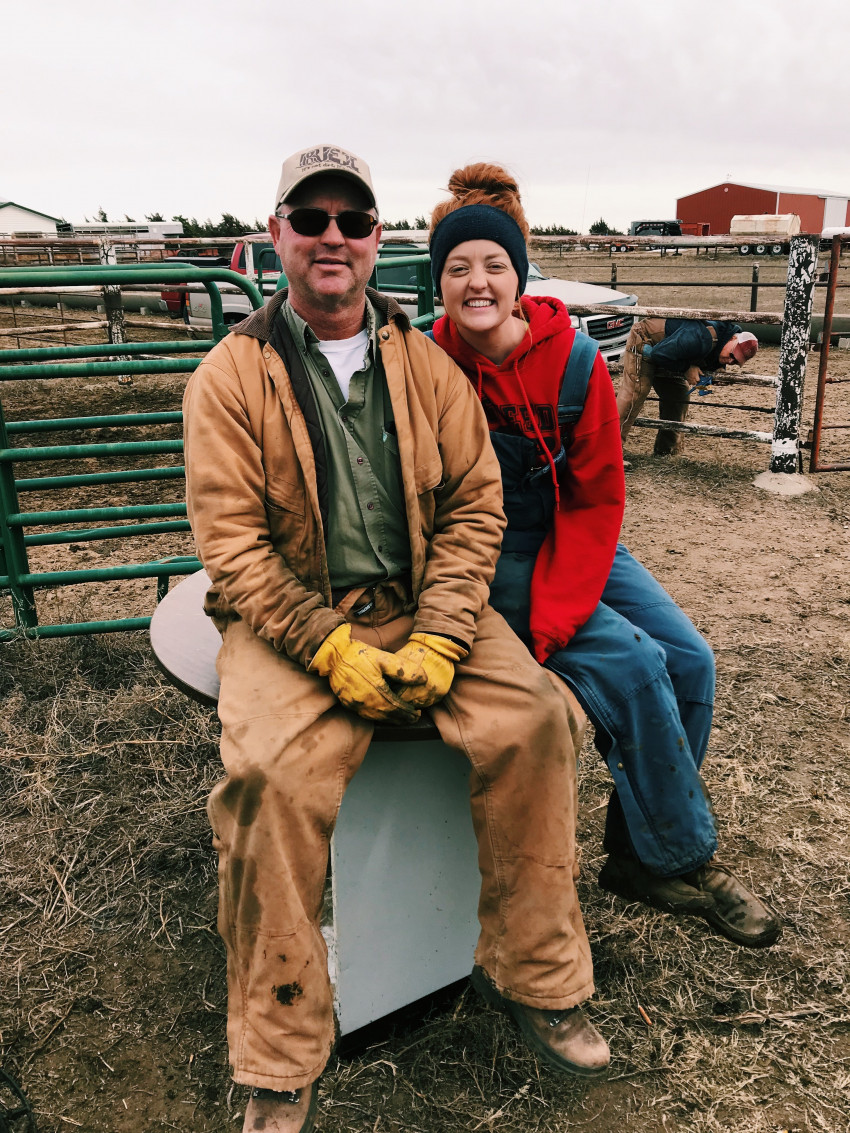 Leigh Ann with her dad working cattle
