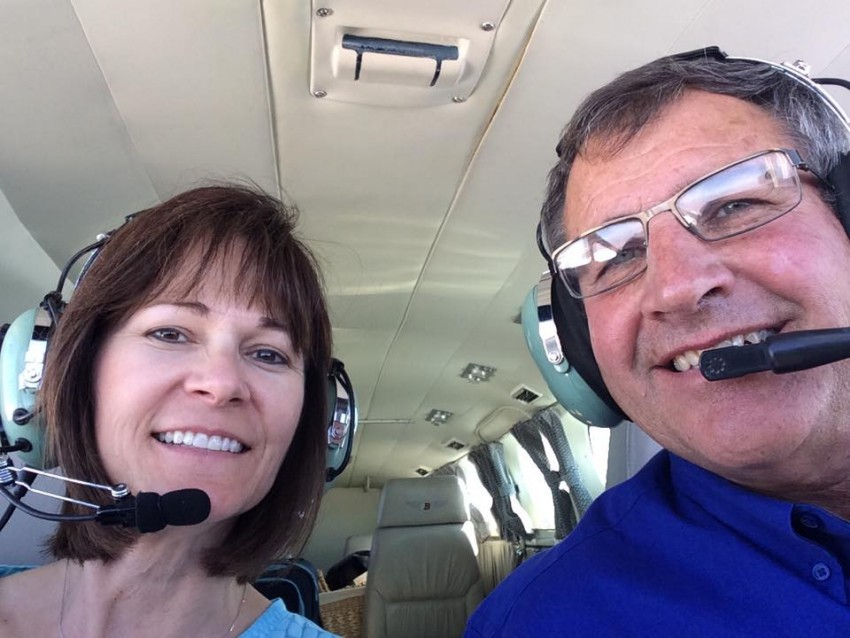 Ken and Colleen Bixenman in crop dusting plane