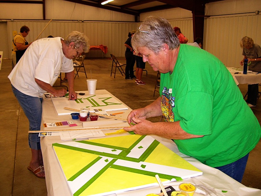 woman making barn quilt
