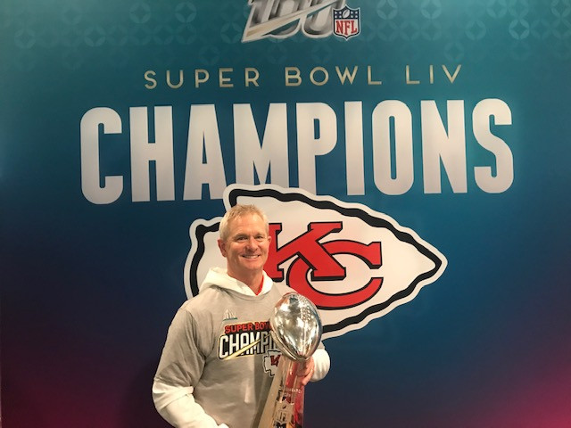 mitch holthus_holding_lombardi_trophy