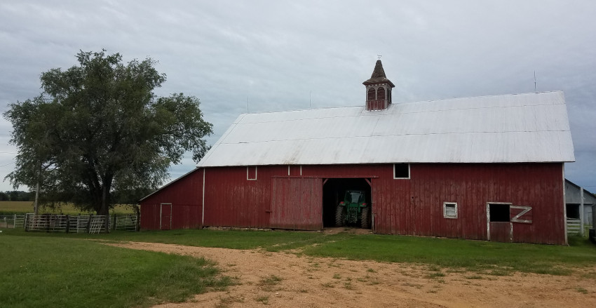 A 40-by-80-foot barn built by Johann Schotte sits on Delmar Schotte's farm today. The barn was moved about a quarter-mile uphill after repeated floods along Horseshoe Creek.