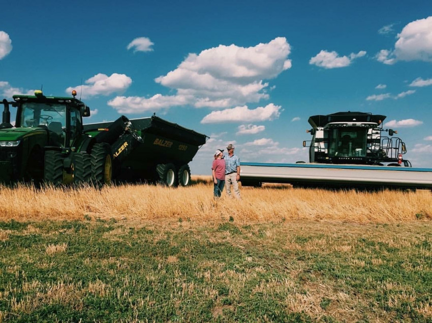 Leigh Ann with her dad during wheat harvest