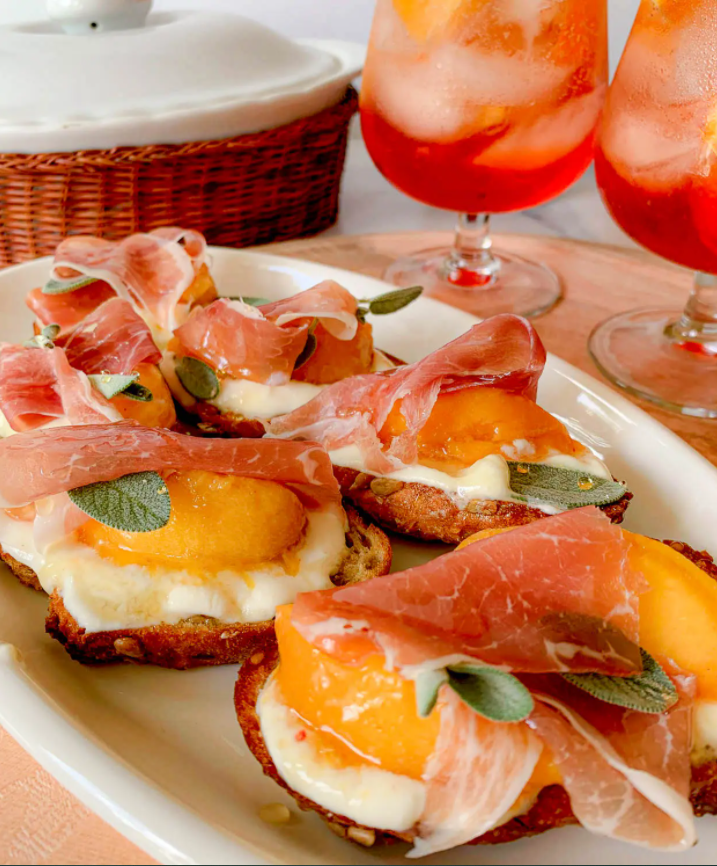 Honey Whipped Ricotta Crostini with Peaches and Prosciutto