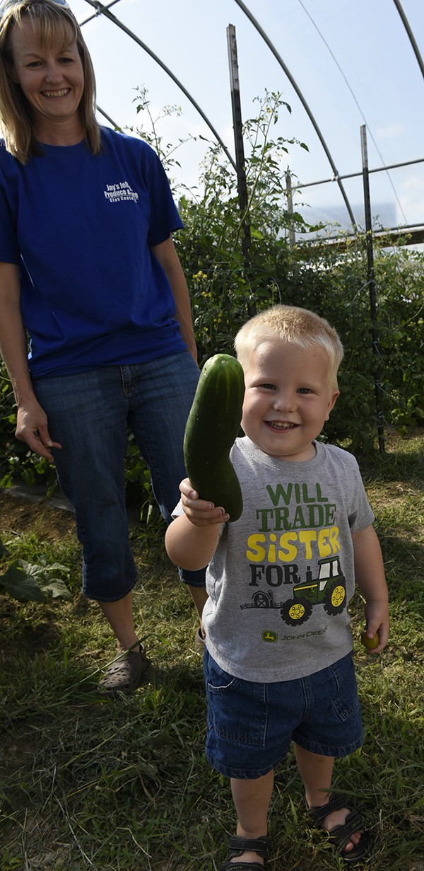 little boy with cucumber