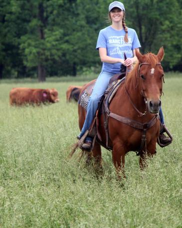 Brandi Buzzard horseback