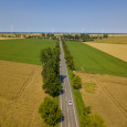 fields, road and wind turbines