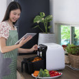 Woman using air fryer