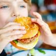 Kid Eating A Burger