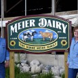Meiers standing at dairy sign