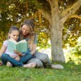 Child and mom reading book