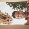 man and woman opening Christmas present