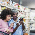 women reading food labels